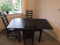 Extendable IKEA dining table and 6 matching chairs