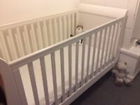 Mamas and Papas Mia Cot bed. Less than a year old, white and no marks, Nearly new.