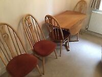 Ercol wooden dining room table for sale.