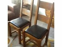 Two solid oak dining room chairs