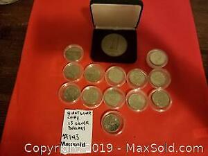 Huge silver colour medal, 13 Canadian silver dollars