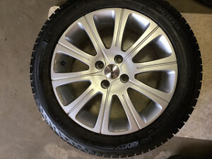 4 pcs Michelin Winter tires with Momo Rims (retail for $1200)
