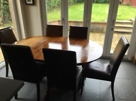 Extending Pedestal Dining Table and 6 leather dining chairs.
