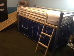 Loft bed with slide and curtain