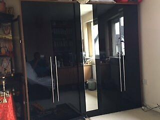 Wardrobe for sale - 2 doors each side + single one with mirror (glossy black)