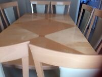 Dining Table in immaculate condition with 8 part cream leather chairs and Matching display cabinet