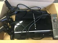 Playstation 3, 2 Controllers, Charging Deck, TV remote control and 16 Games