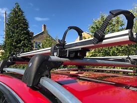 Roof rails and 2 cycle carriers complete with locks for C class Mercedes. Excellent condition.