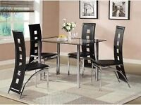 GLASS DINING TABLE AND FOUR CHAIRS - CHAIRS ARE ASSEMBLED