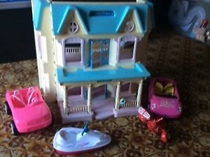 Fisher price doll house & barbie dolls etc.