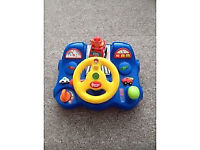 Baby toy steering wheel ideal to keep the baby entertained in his hi chair or car seat .