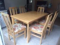 Solid wooden extendable dining table plus 6 matching chairs.