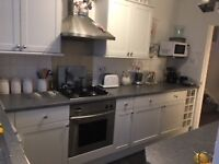 White Kitchen units, fridge,freezer,oven,gas hob, breakfast bar,work tops AND glass table & 4 Chairs