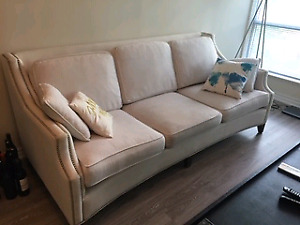 White couch with custom embroidery