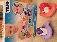 Tomy Do Re Mi Dolphins bath toys