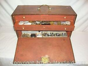 Antique watchmaker tool box full with watch movements, cases ,crystals ,and other parts .