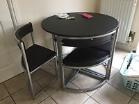 Space saving kitchen table and 4 chairs