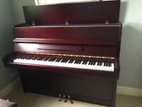 Modern upright piano in excellent condition. Mahogany veneer. Tuned 5 years ago.