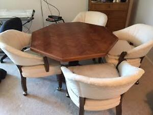 42 inch Dining table and 4 upholstered rolling chairs