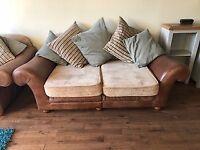 2 x tan leather sofas