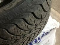 235/70 R16 Goodyear Ultragrip Winter tires on rims