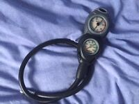 suunto console, wrist mounted compass, oceanic gear gulper and mask, all as new condition