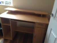 Sturdy desk , light pine colour , with drawer, cupboard and shelves.