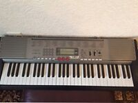Casio LK230 Keyboard with Lightup Keys complete with stand