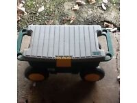 Portable tool box or garden storage with seat.