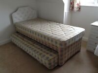 Single bed with guest trundle underneath with mattresses and headboards - excellent condition.