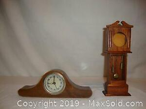 Antique small clock and pocket watch stand in shape of grandfather clock.