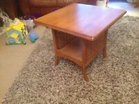 NICE TEAK COLOURED TABLE WITH RATTAN SIDES AND LOWER SHELF