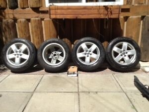 "Four VW 15"" aluminum rims with Blizzak WS80 tires"