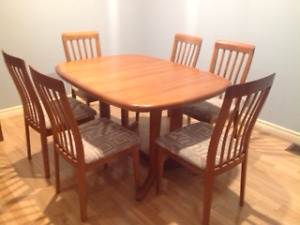 Teak dining room table and 8 matching chairs