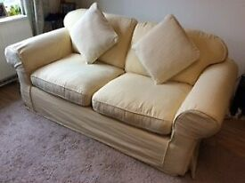 Pale yellow sofa bed.