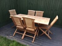 6 seater, teak rectangular BBQ table and chairs. Never been used, all folds easily for storage.