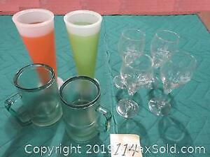 four wine glasses, Two pre-freezable plastic beer mugs Two pre-freezable tall plastic glasses