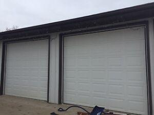 Two 9x10 white insulated garage doors