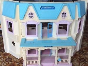 Fisher price doll house & barbie dolls & lots more