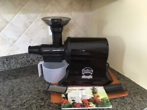 Champion 2000+ juicer with recipe book