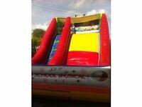 Price drop. Mega slide / Bouncy castle for sale 30ft long x 20ft wide