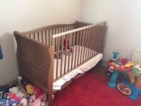 2 High quality Oak cots which convert to toddler beds