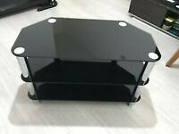 Black glass tv stand in Good condition and no damage no issue