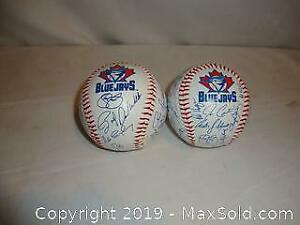 2 Blue Jays official baseball balls with signatures