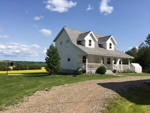 Country Home on 10 acres for sale in Charlie Lake Area