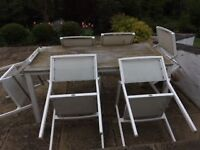Outdoor garden dining table in oak and Mesh chairs, white metal. Made by Gloster