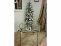 IKEA dining table glass round seats 4.