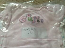 Girls baby vests in various sizes.