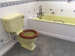 An Unusual Yellow Bathroom Suite With