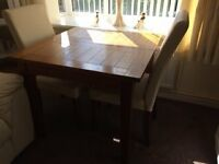 Oak table and four Cream Faux Leather chairs